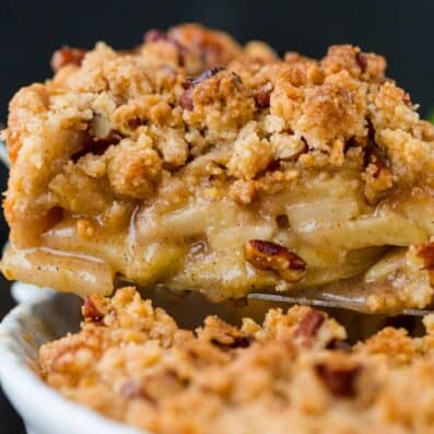 Slice of dutch apple pie with crumb topping