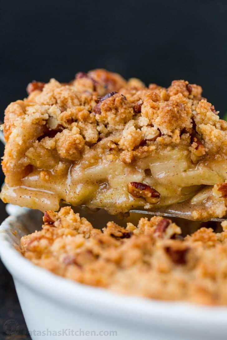 Dutch apple pie slice on a spatula