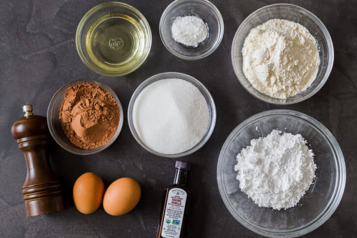 Ingredients for crinkle cookies with flour, cocoa powder, sugar, eggs, vanilla, oil