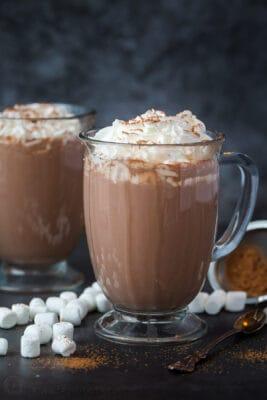 homemade hot chocolate in mugs with whipped cream