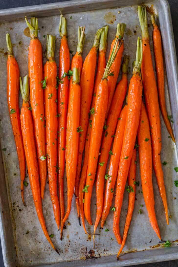 peeled roasted carrots on a baking pan