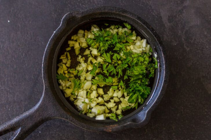 Garlic infused oil with parsley for drizzling over carrots