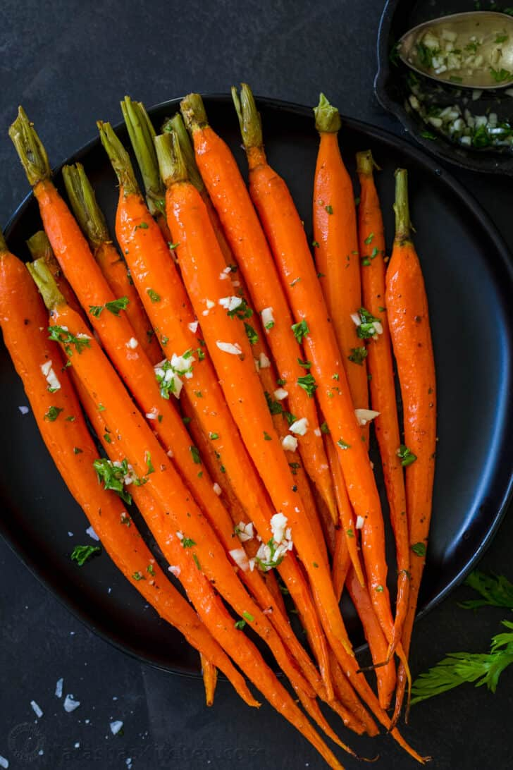 Roasted Carrots on a plate served with garlic oil.