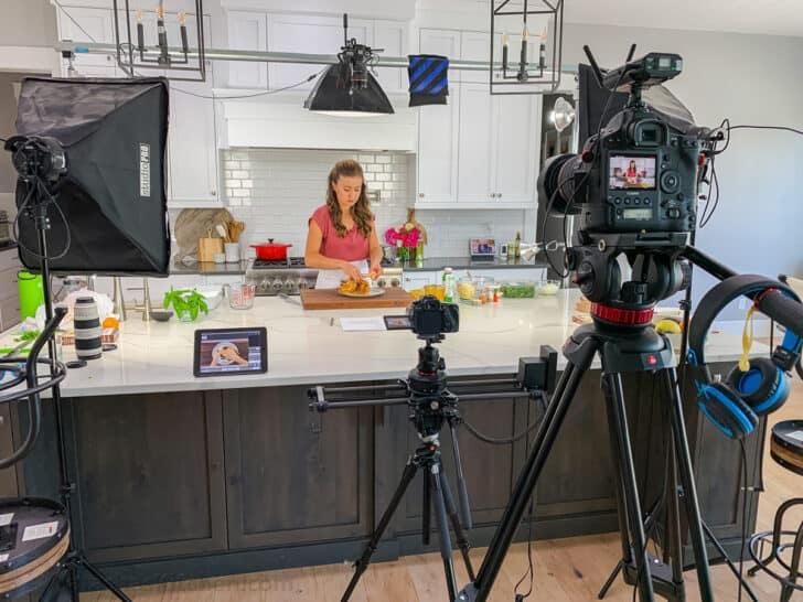 Natasha in kitchen with camera equipment behind the scenes