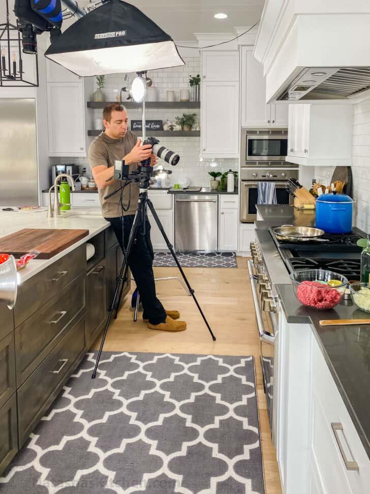 Camera man pointing camera at stove