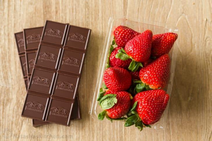 Chocolate bars and fresh strawberries
