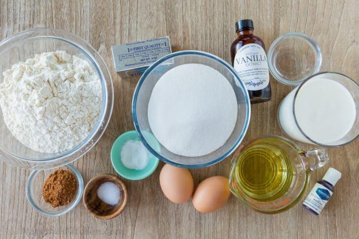 Ingredients for red velvet cake with cocoa, flour, sugar, eggs, oil, butter, buttermilk, vinegar, baking soda