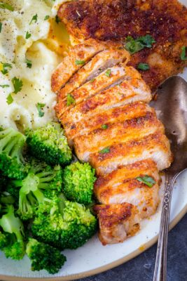 Air Fryer Pork Chops on a plate with broccoli and potatoes