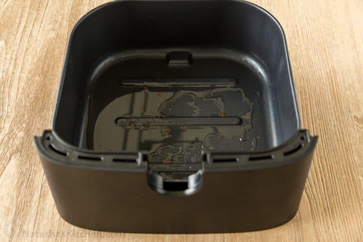 Oil in air fryer drip pan