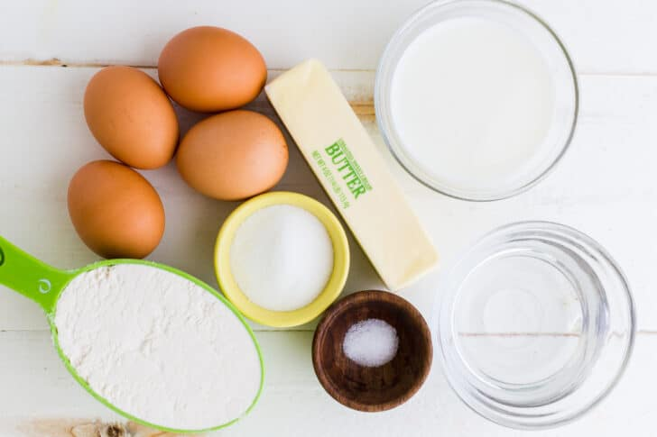 Ingredients for Zeppole Italian Donuts with eggs, milk, butter, flour, sugar, salt, water