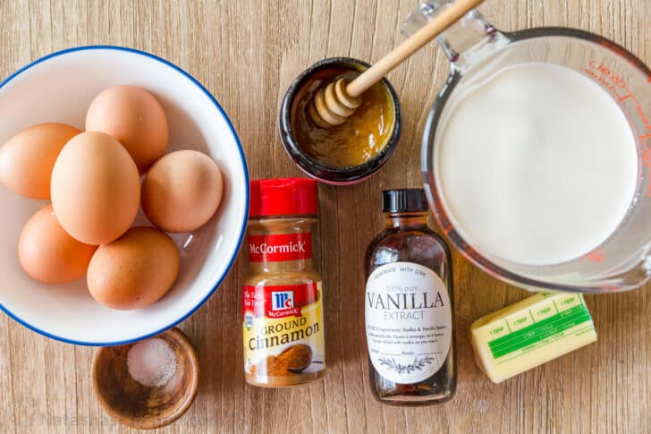 Ingredients for making French toast with eggs, milk, cinnamon, honey, butter, salt