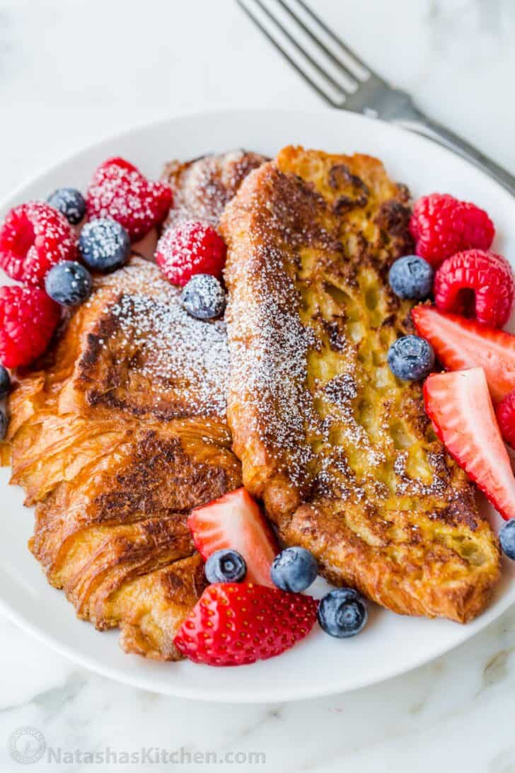 Croissant French toast on plate with berries