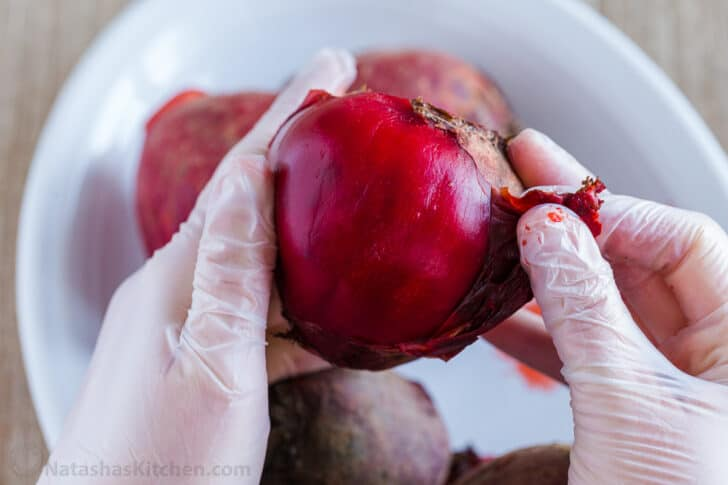 Peeling cooked beets with gloves