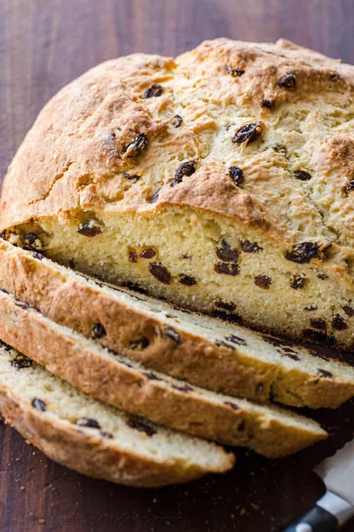 Perfectly baked Loaf of Irish soda bread sliced into pieces