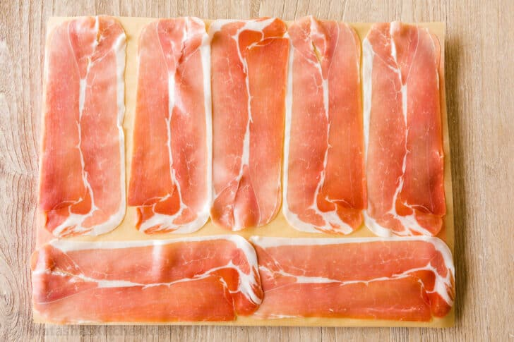 Slices of prosciutto on parchment paper