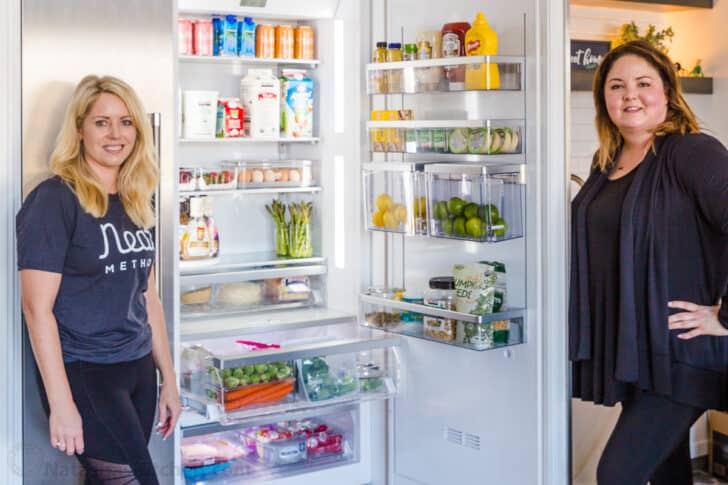two women organizing refrigerator