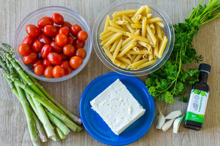 Ingredients for baked pasta with feta and tomatoes