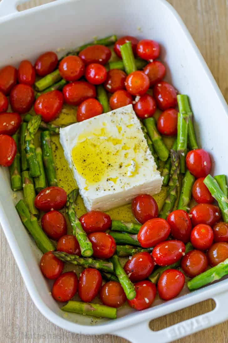 Feta and tomatoes in casserole dish for baked feta pasta
