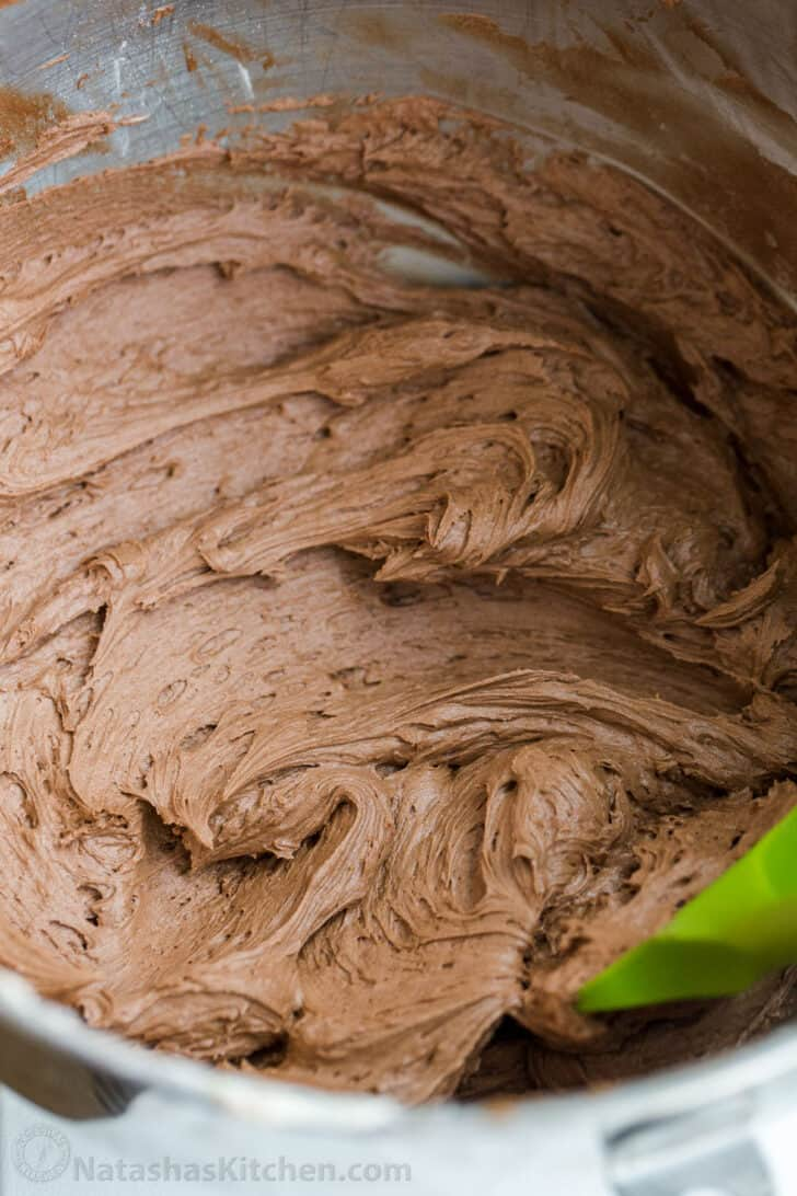 Whipped chocolate buttercream frosting made in a mixing bowl