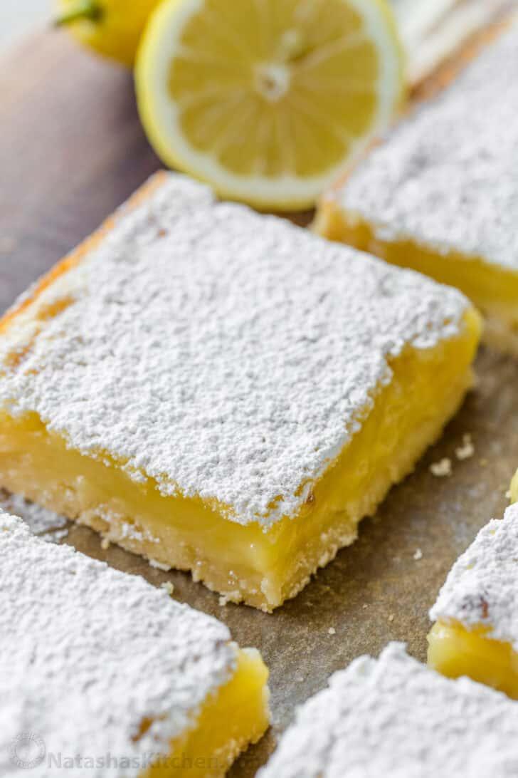 Up close lemon bar with lemon custard filling