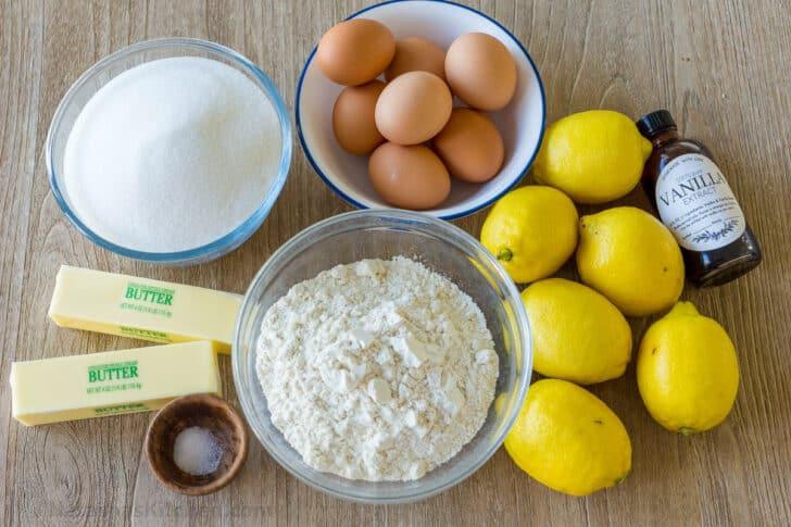 Ingredients for making lemon bars with lemons, eggs, flour, butter, sugar, vanilla and salt
