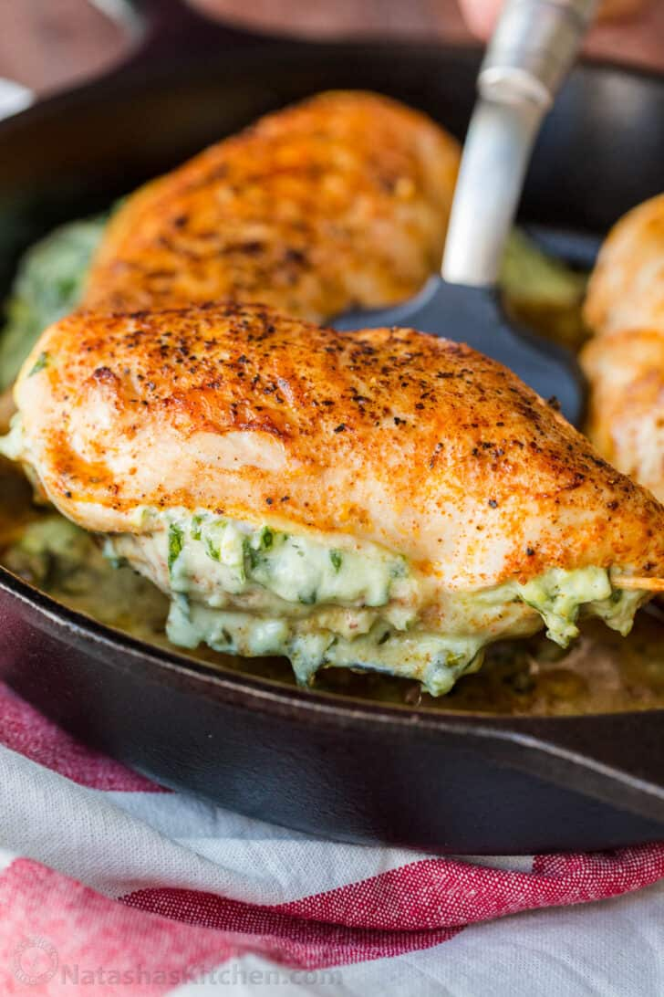 Chicken breast stuffed with cheesy spinach on a spatula