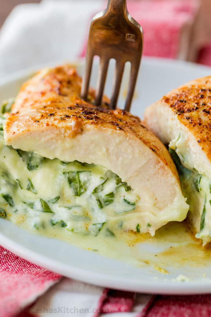 Up close sliced stuffed chicken breast on fork