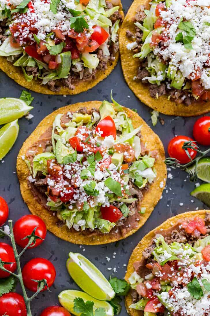 Tostadas served with toppings on a platter