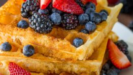 homemade waffles stacked on a plate
