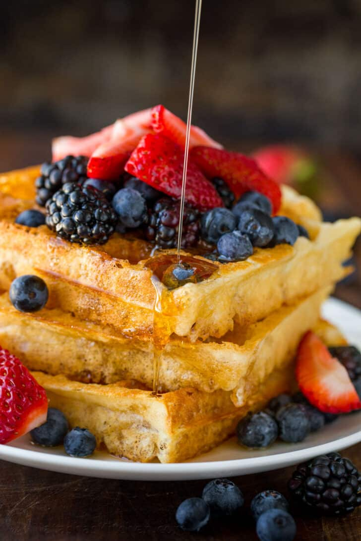 Waffles served with syrup and berries
