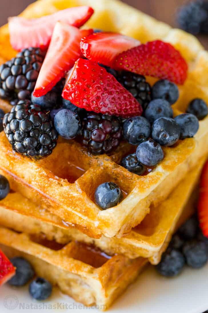 best fluffy waffles stacked on a plate