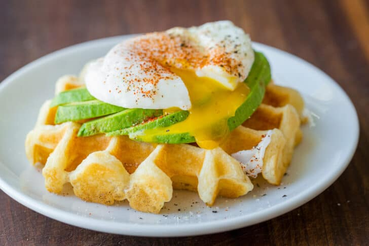 Savory waffle with avocado and poached egg