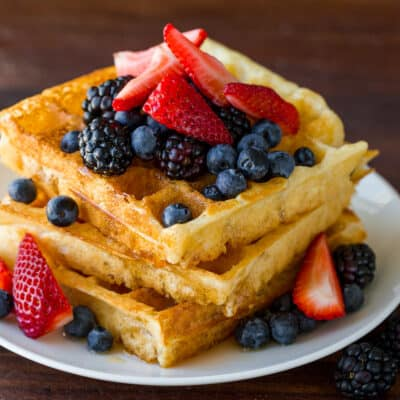 Stack of homemade waffles with berries