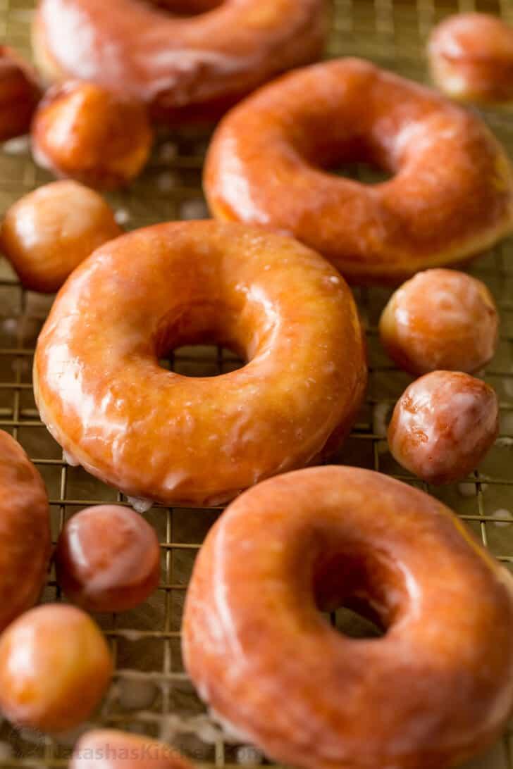 homemade glazed donuts resting on rack