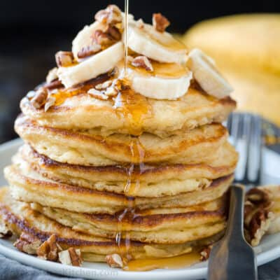 Banana pancakes stacked on a plate