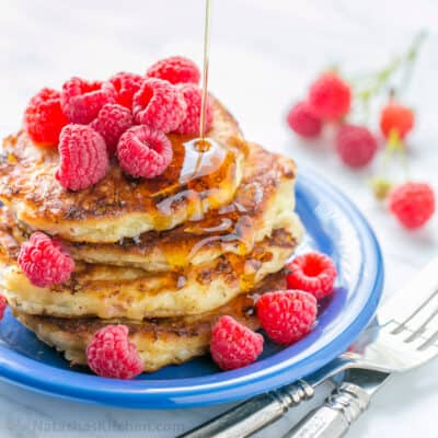 Stack of cottage cheese pancakes drizzled with syrup
