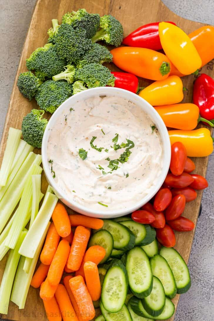Veggie Dip arrange on a platter with fresh vegetables.