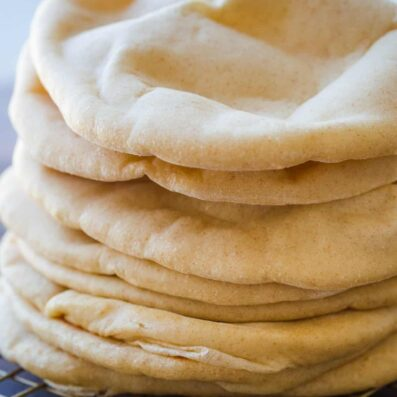 Pita Breads stacked on wire rack