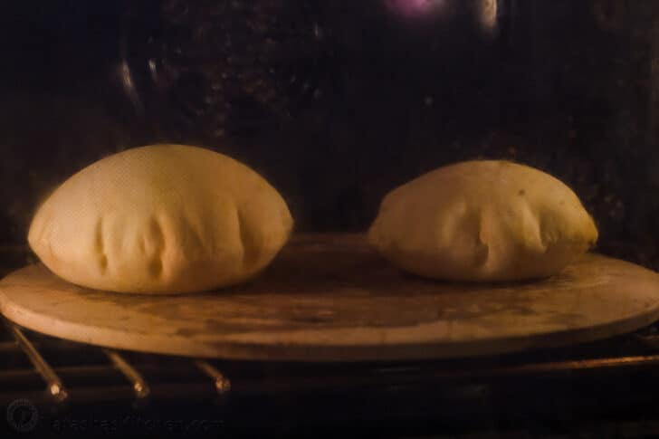 Pita bread puffing in the oven