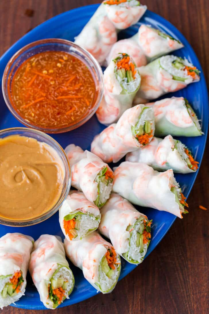Fresh spring rolls on platter with dipping sauce