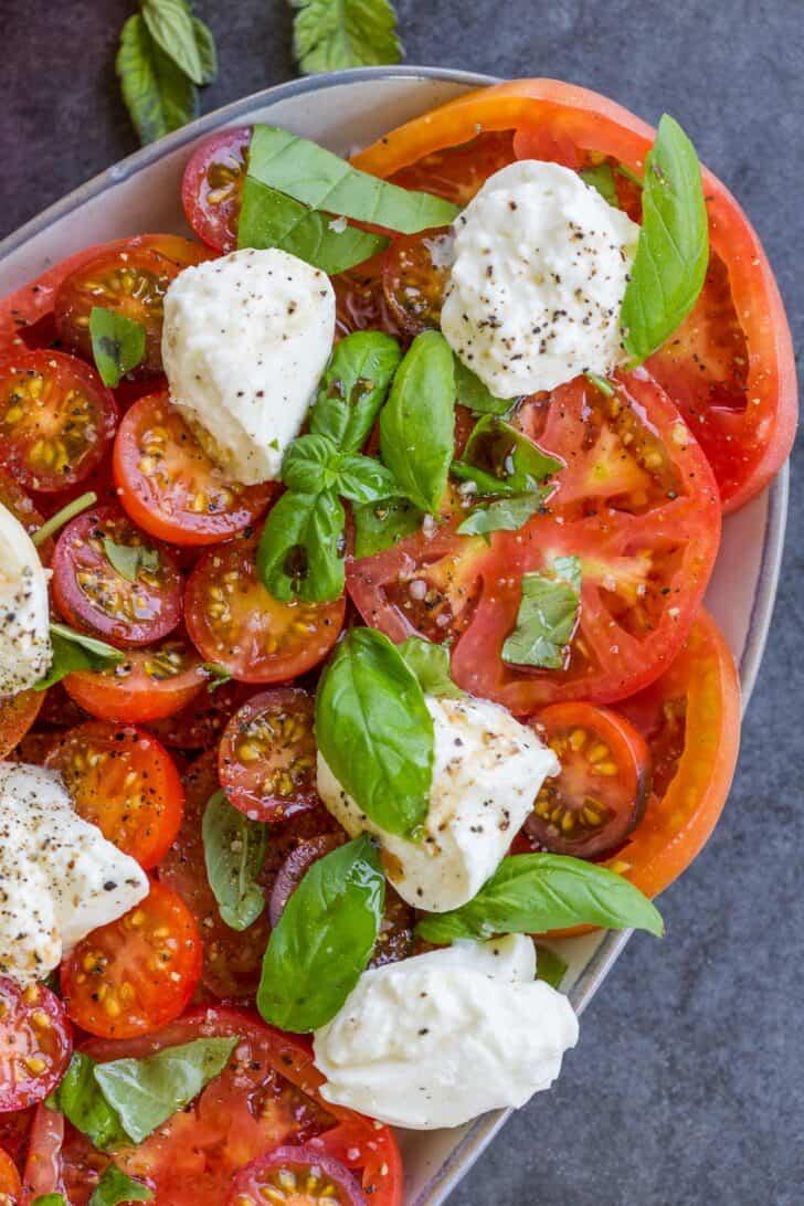 tomato burrata salad on a plate