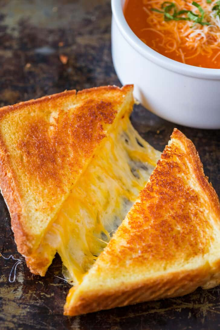 Grilled cheese sandwich served with tomato soup