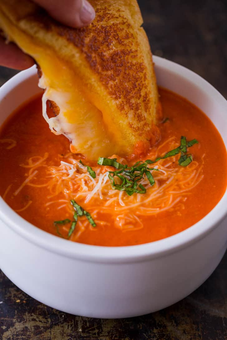 Serving tomato soup with a grilled cheese sandwich