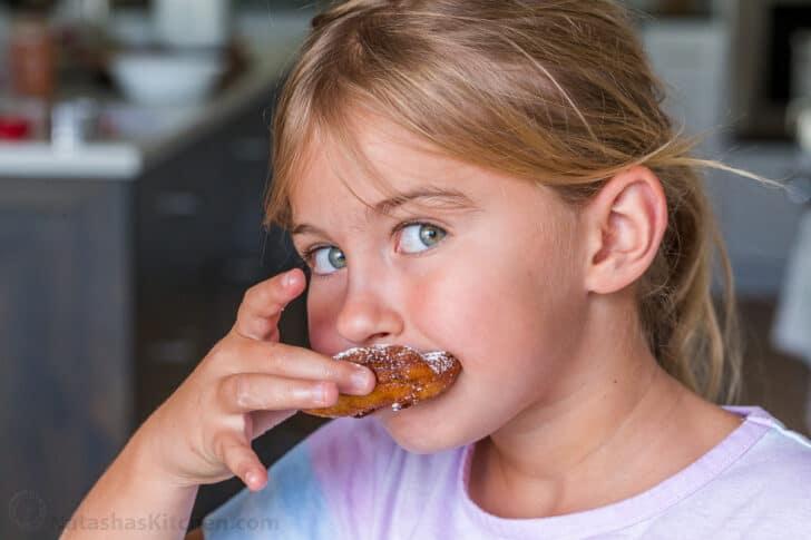 child eating apple fritter
