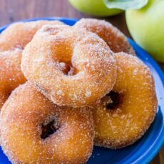 Apple fritters coated in cinnamon sugar served on plate