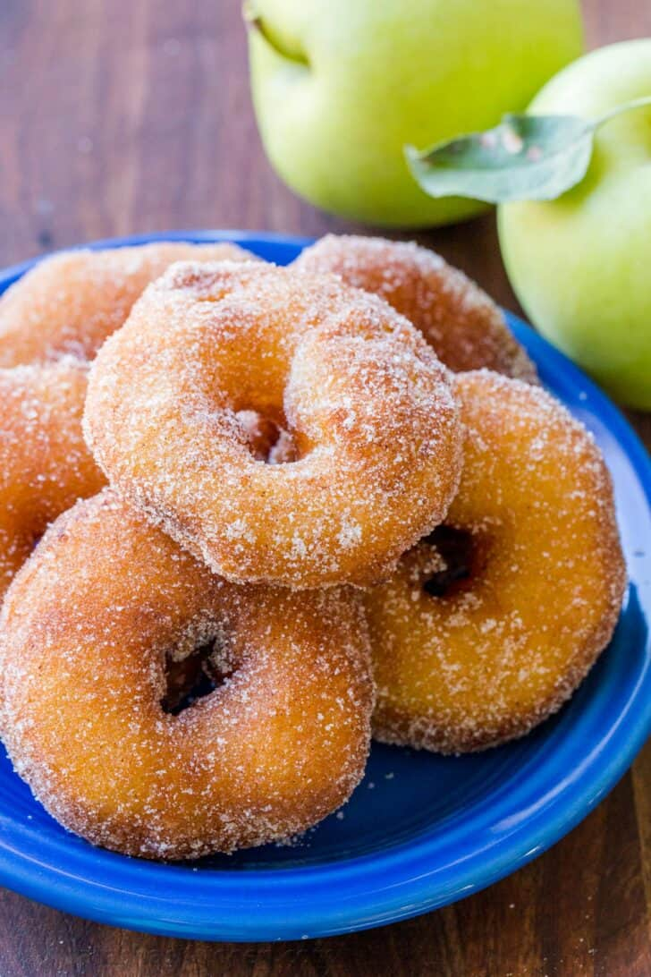 Apple fritters covered with cinnamon sugar on a plate