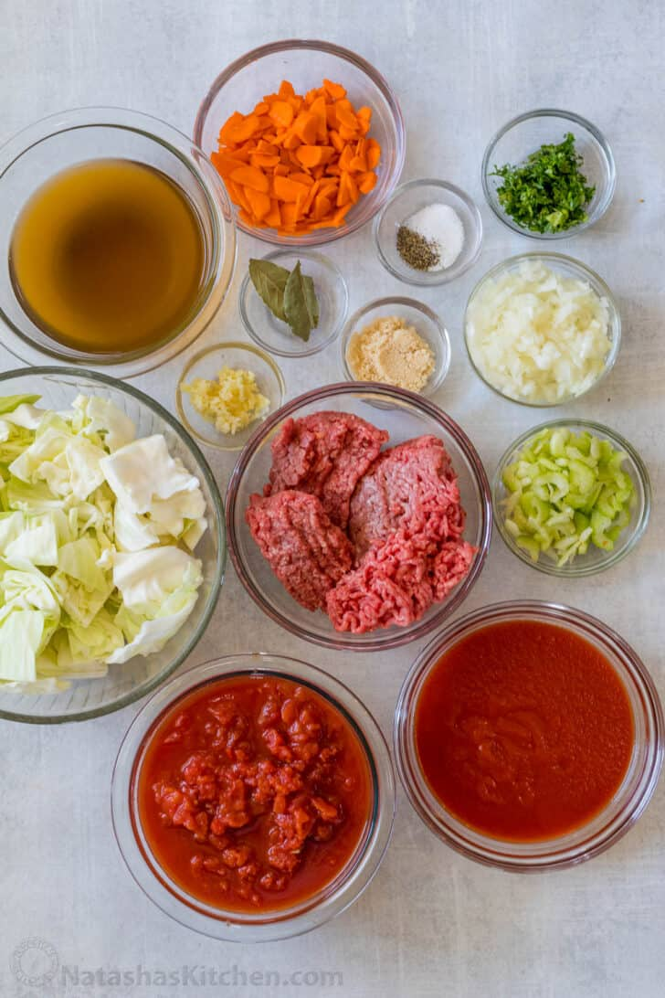 All the ingredients for cabbage soup in bowls.