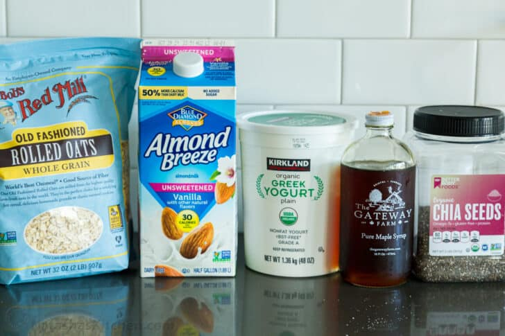 Ingredients for making oats overnight with rolled oats, almond milk, yogurt, chia and maple syrup