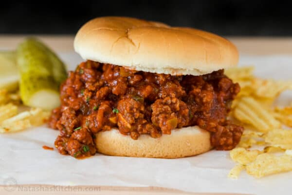 Sloppy Joe sandwich served with chips and pickles