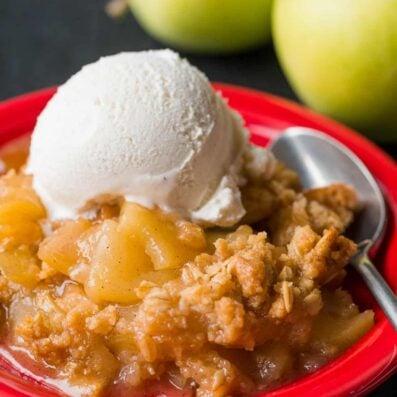 Apple crisp served on plate with ice cream